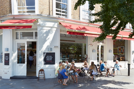 europeans: People relaxing in outdoor tables, near cafe in Portobello road in summer in London
