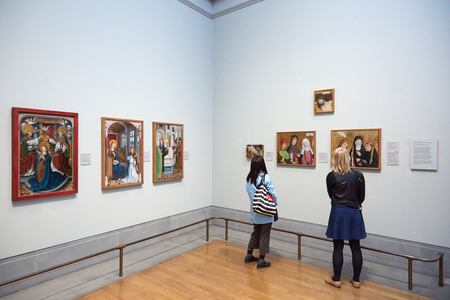 Women looking at National Gallery paintings in London