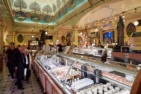 harrods: Harrods department store interior, food area with people in London Editorial