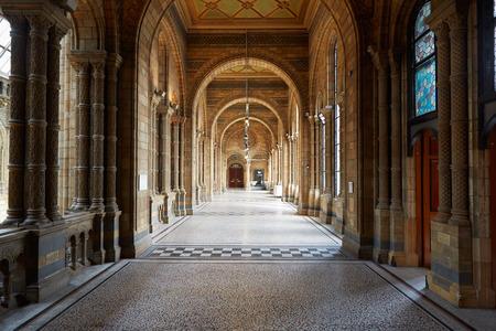 natural history museum: Natural History Museum ancient architecture of empty corridor interior in London