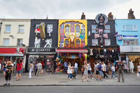 Camden Town colorful shops with people in London