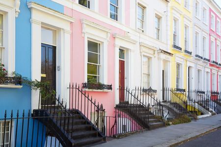 Colorful English houses facades in blue, pink, yellow and white colors in London
