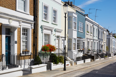 Colorful English houses facades in a sunny day in London