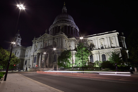 illuminated: St Pauls cathedral illuminated at night in London, empty street and car passing lights Stock Photo