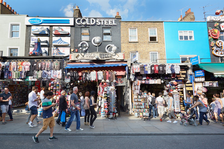 body piercing: Camden Town colorful shops with people in London