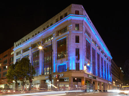 spencer: Marks & Spencer building in Oxford street illuminated at night in London Editorial