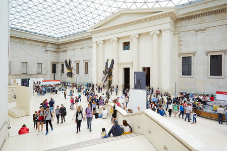 british people: British Museum Great Court interior with stairway and people in London