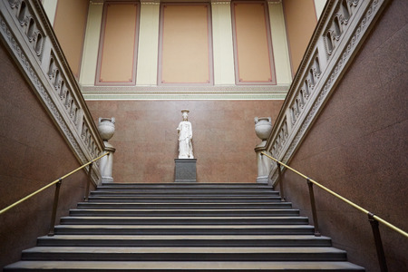 ornated: British Museum ancient stairway with Roman white statue and two amphoras in London