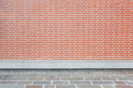 tiled wall: Red brick wall with stone tiled floor and bench