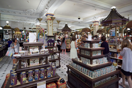 harrods: LONDON - AUGUST 7:  Harrods department store interior, candies and sweets area on August 7, 2015 in London, UK. Harrods is the biggest department store in Europe.