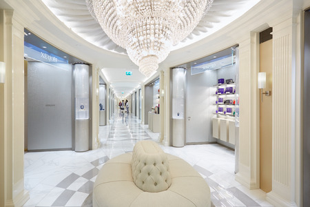 harrods: LONDON - AUGUST 7:  Harrods department store interior, perfumery area with sofa and glass chandelier on August 7, 2015 in London, UK. Harrods is the biggest department store in Europe.