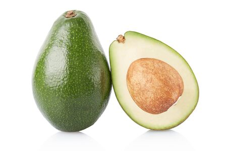 sliced: Avocado and section isolated on white, clipping path