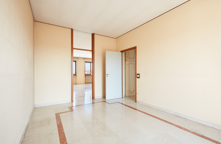 unfurnished: Large empty room interior with marble floor