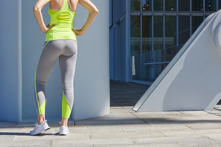 outdoor sport: Woman body before outdoor sport in the city sunlight