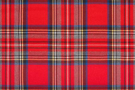 Red tartan, checkered scottish fabric macro, texture background