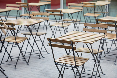 restaurant tables: Restaurant empty sidewalk wooden tables Stock Photo