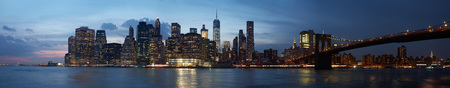 New York city skyline panorama with Brooklyn bridge at sunset, natural colors