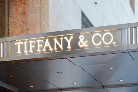 Tiffany e Co. shop sign Fifth Ave illuminated on September 12, 2016 in New York. Tiffany is an American internationally renowned luxury jewelry retailer. Redakční