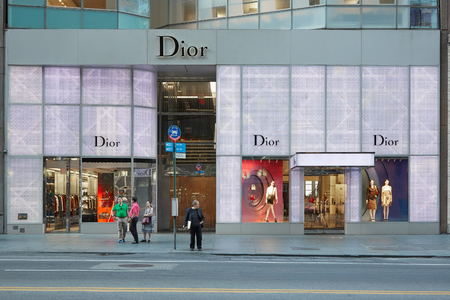 Christian Dior shop illuminated at dusk in 57 th Street on September 12, 2016 in New York. Dior is a fashion house founded in 1946 in Paris specialized in haute couture and luxury goods