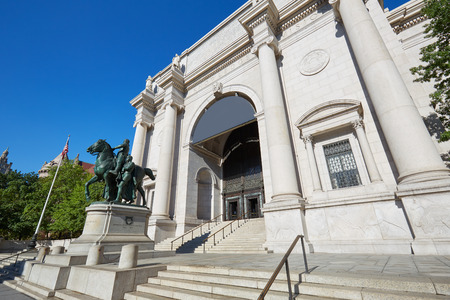 American Museum of Natural History building facade in a sunny day, clear blue sky on September 13, 2016 in New York. This is one of the largest museum of natural history of the world.