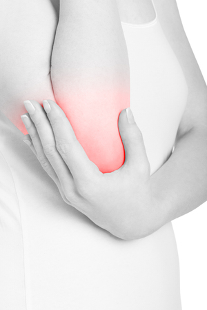 acute: Woman holding elbow in pain isolated on white, clipping path Stock Photo