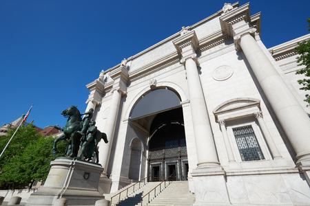 NEW YORK - SEPTEMBER 13: American Museum of Natural History building facade with Theodore Roosevelt statue in a sunny day, blue sky on September 13, 2016 in New York. This is one of the largest museum of natural history of the world. Editorial