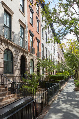 Townhouse buildings in Chelsea, New York in a sunny day Stock Photo