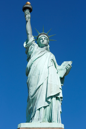 Statue of Liberty, front view in a sunny day, blue sky in New York