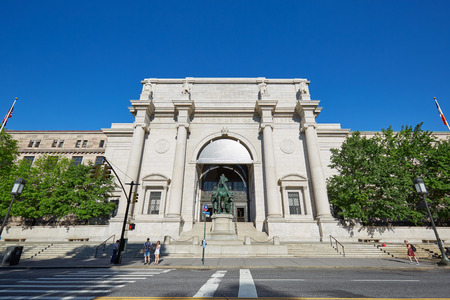 American Museum of Natural History building facade with people in a sunny day, blue sky on September 13, 2016 in New York. This is one of the largest museum of natural history of the world.