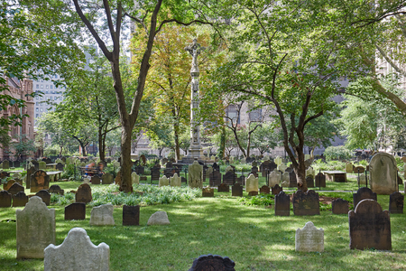 Trinity Church cemetery with green grass in a sunny day. This is the only active cemetery in Manhattan. Editorial