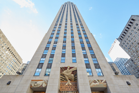 Rockefeller Center building, blue sky on September 12th, 2016 in New York. Rockefeller Center is a large complex of 19 commercial buildings, located in the center of Midtown Manhattan. Editorial