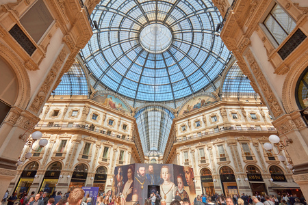 MILAN - SEPTEMBER 20: Galleria Vittorio Emanuele interior with people and The Parlour of Jewels installation in a sunny day on September 20, 2017 in Milan. The gallery in the center of the city hosts many luxury brands stores and restaurants.
