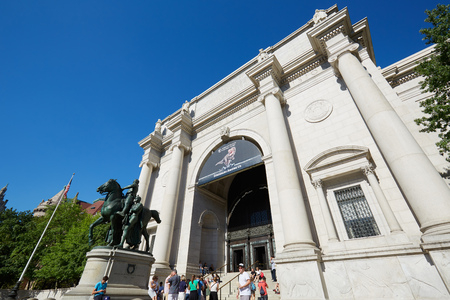 NEW YORK - SEPTEMBER 13: American Museum of Natural History building facade and Theodore Roosevelt statue with people in a sunny day, clear blue sky on September 13, 2016 in New York. This is one of the largest museum of natural history of the world.