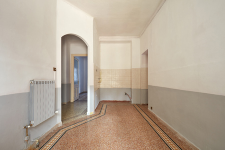 Empty living room and kitchern area interior with tiled floor