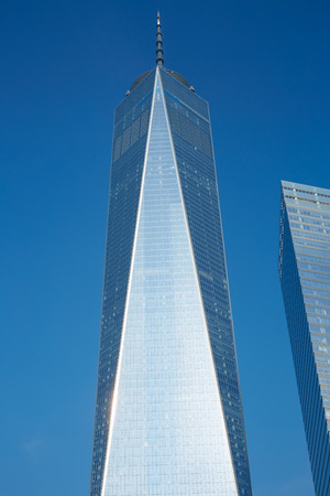 NEW YORK - SEPTEMBER 8: One World Trade Center skyscraper, clear blue sky in a sunny day on September 8, 2016 in New York. The Freedom Tower is the sixth tallest building in the world.