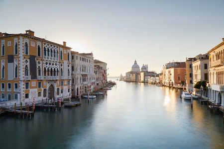Venice, Grand Canal at sunrise with Saint Mary of Health basilica in Italy