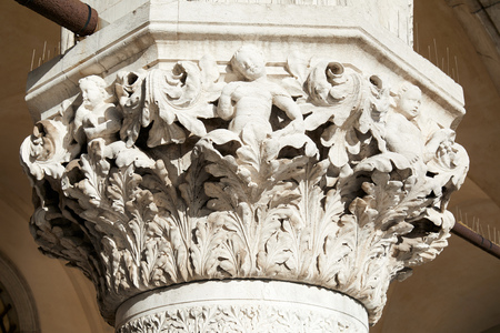 Venice, white capital sculpture with cherubs