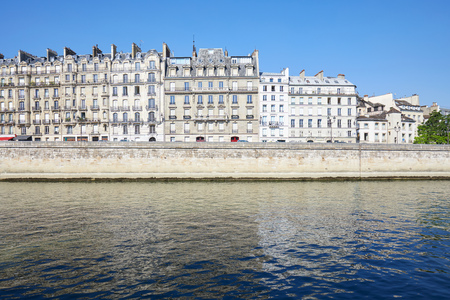Paris buildings facades and Seine river in a sunny summer day in France