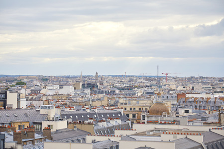 Paris rooftops view and skyline in a cloudy day in France