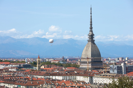Turin skyline view, Mole Antonelliana tower and hot air balloon in a sunny summer day in Italy Stok Fotoğraf