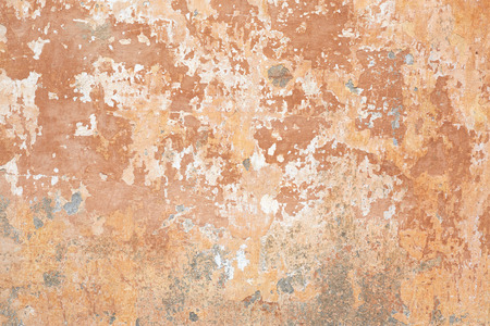 Old beige chipped wall texture background in Italy