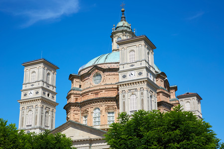 Sanctuary of Vicoforte church with bell tower and red bricks building in a sunny summer day in Piedmont, Italy Imagens