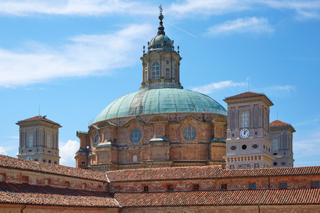 Sanctuary of Vicoforte church and red rooftops in a sunny summer day in Piedmont, Italy