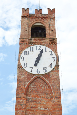 Belvedere ancient clock tower in a summer day in Mondovi, Italy.