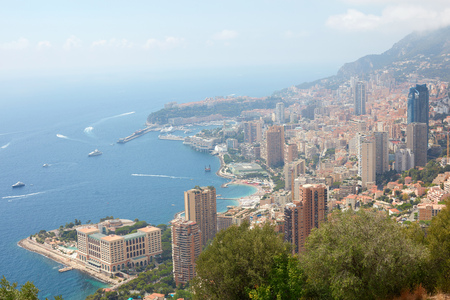 Monte Carlo, high angle city and coast view with mist in a sunny summer morning in Monaco