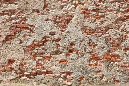 Old bricks and concrete wall texture background, sunlight Imagens