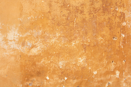 Old yellow faded wall texture background