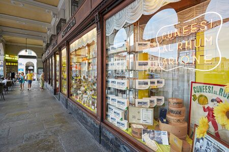 CUNEO, ITALY - AUGUST 13, 2016: Arione ancient pastry shop and people in a summer day in Cuneo, Italy.