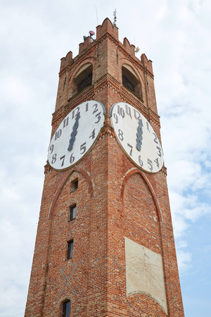 Belvedere ancient clock tower low angle view in a summer day in Mondovi, Italy. Imagens