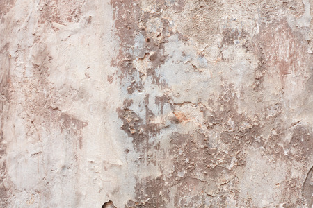 Old beige chipped wall with humidity stains texture background Imagens